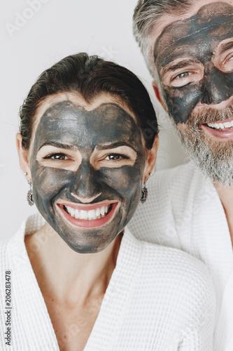 Fotobehang Wintersporten Happy couple wearing a charcoal mask