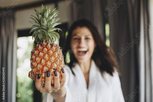 Fotobehang Wintersporten Woman in a bathrobe holding a pineapple