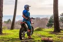 Man Riding A Motocross In A Pr...