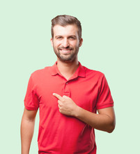 Young Handsome Man Pointing Himself Wearing Red Polo Shirt . Person Isolated Against Monochrome Background
