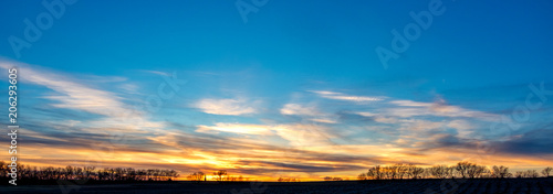 Fotomural Vibrant fall sunset over Kansas prairie