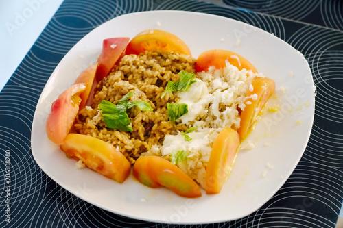 Healthy typical italian tomato dish and tuna fish and rice