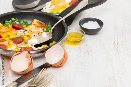 omelet with potato, peas and smoked sausages