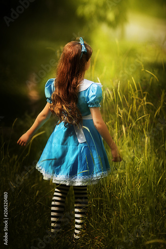 Alice in Wonderland.little girl in costume alice in wonderland Wallpaper Mural