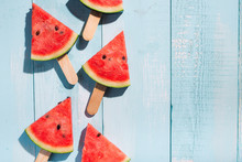 Slices Of Watermelon On Blue W...