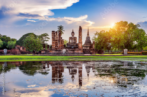 Fotobehang Boeddha Buddha statue and Wat Mahathat Temple in the precinct of Sukhothai Historical Park, Wat Mahathat Temple is UNESCO World Heritage Site, Thailand.