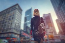 Business Woman Walking Through...