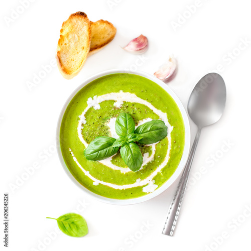 Spinach soup with cream in a bowl. Broccoli and Spinach creamy soup with  croutons isolated on white background, top view. Close up. Detox healthy  food.