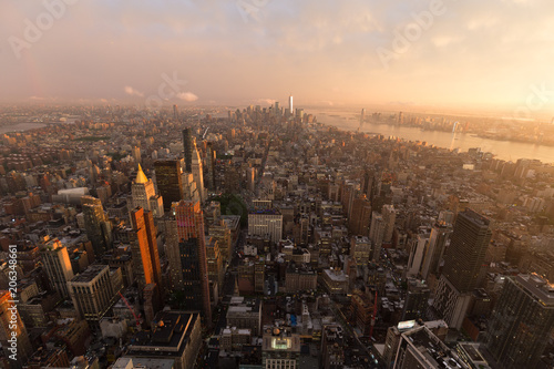 Foto op Plexiglas New York City New York City skyline with Manhattan urban skyscrapers at dramatic after the storm sunset, USA.