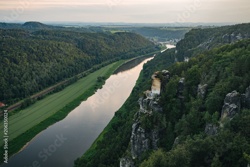 Spoed Foto op Canvas Khaki Sunset in beautiful landscape at Saxony Switzerlandю The valley of the river in mountain landscape. Ecology concept. The view from the Elbe sandstone mountains