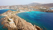 Aerial drone bird's eye view of famous Paraga beach featuring iconic beach bar of Skorpios and Santa Anna, Mykonos island, Cyclades, Greece