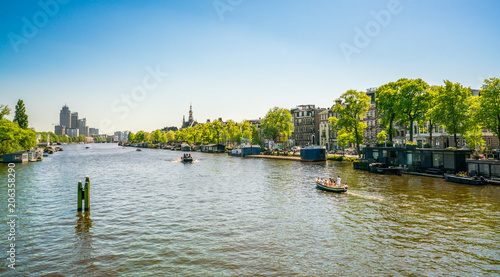 Amsterdam, May 7 2018 - view from the New Amstelbrug on the river Amstel near th Canvas Print
