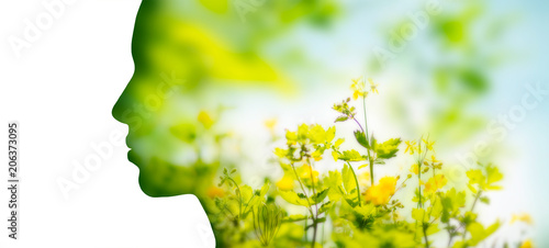 Poster Natuur beauty, nature and ecology concept - portrait of woman profile with yellow spring flowers with double exposure effect