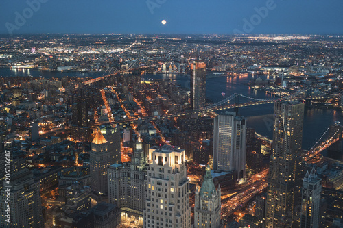 Aerial view of illuminated cityscape against clear sky at night