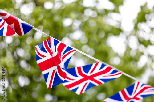 Union Jack bunting flapping in the breeze celebrating British event outside with Canvas Print