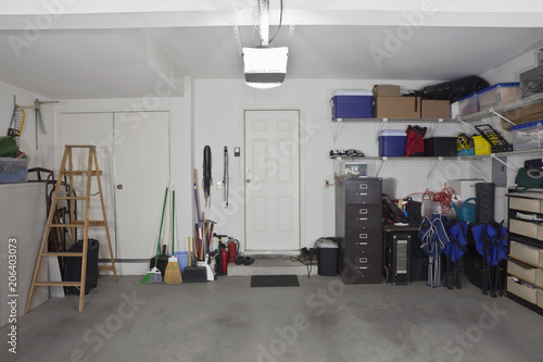 Photo Clean two car garage in a normal suburban home.