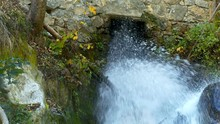 Water Comes Out From Old Stone Mill On The River