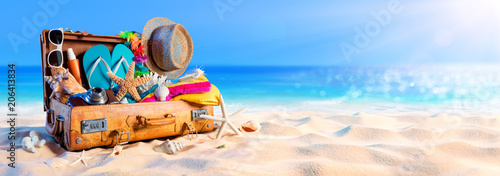Fototapeten Strand Beach Preparation - Accessories In Suitcase On Sand