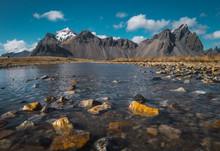 Cold Crystal Stream Among Rocks