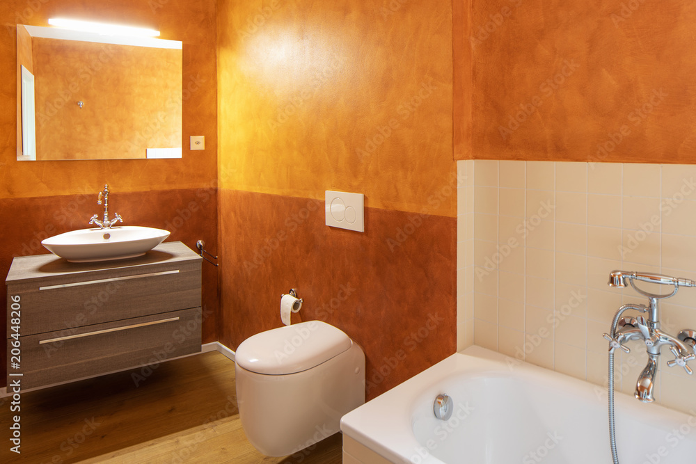 Fototapety, obrazy: Bathroom with modern finishes and orange walls