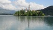Famous landmark. Island in Lake Bled with church in the Julian Alps, Slovenia. Bled in spring, popular tourist and traveldestination.