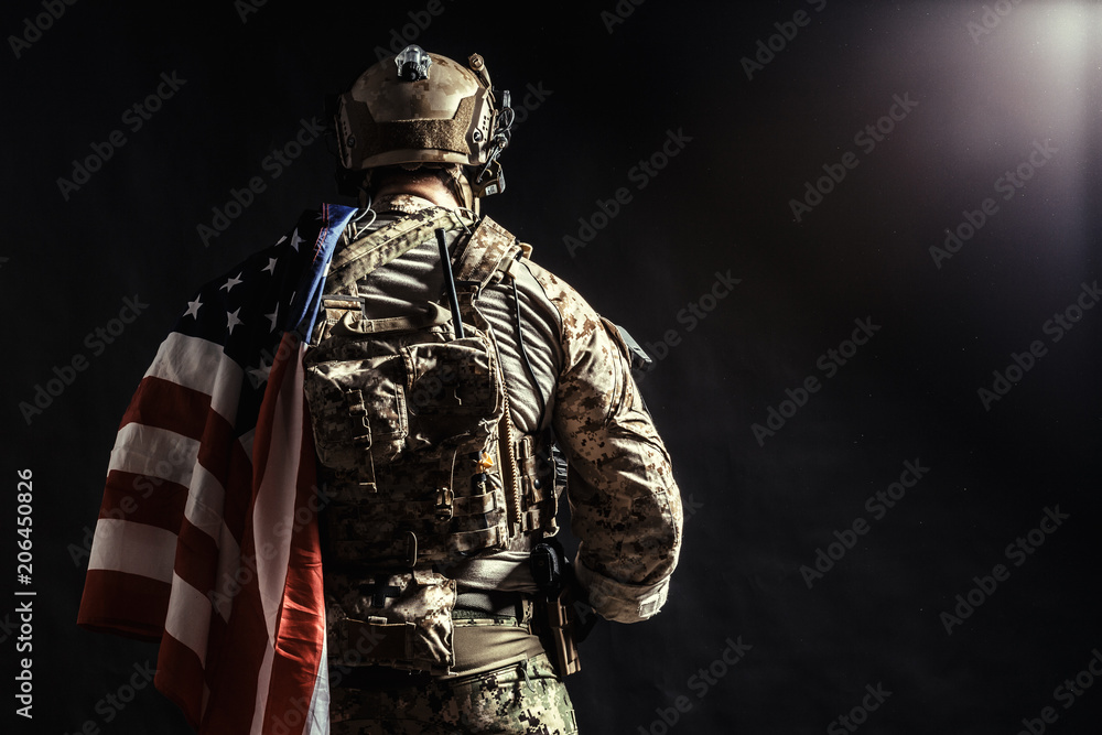 Fototapety, obrazy: Soldier holding machine gun with national flag