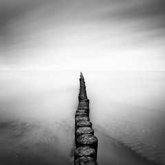 Fototapeta Do sypialni The Baltic Sea coast with pier during rainy day, Usedom, Germany.