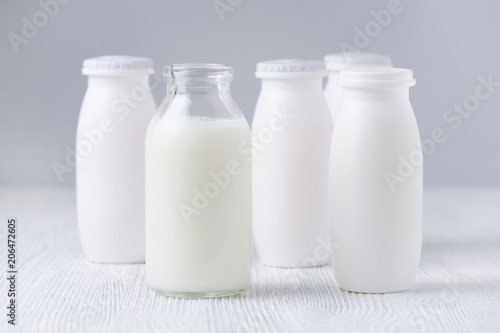 bottles of drink yogurt, glass and plastic Canvas Print