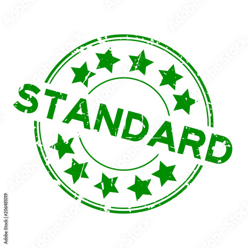 Grunge green standard wording with star icon round rubber seal stamp on white ba Fototapete