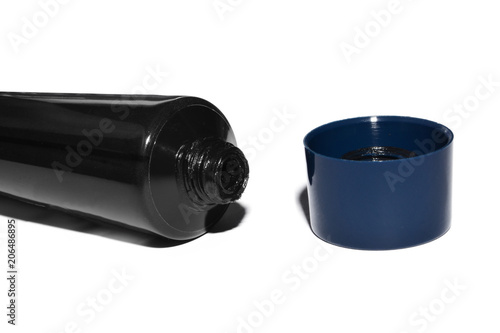 Fotografía  open black tube with lubricant for auto repair, product on white background
