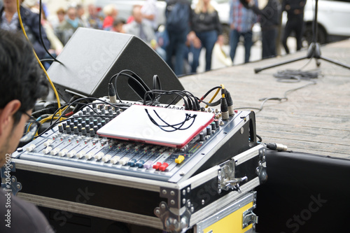Fototapeta  Sound engineer and the digital mixing console in a street show