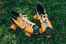 Close-up View Of Vintage Roller Skates On Green Grass