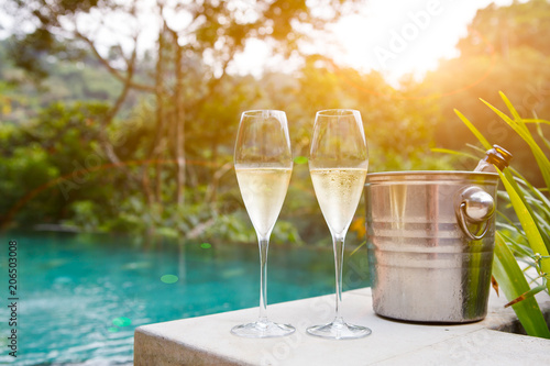 glasses of champagne near pool