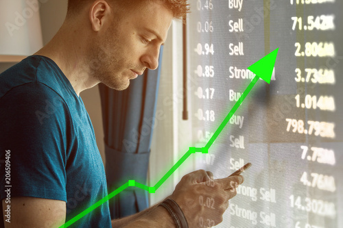 Man on mobile device for trading and stock market upward trend Poster