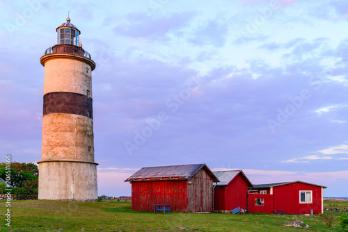 Foto op Aluminium Vuurtoren The lighthouse and surrounding landscape at Morups Tange outside Falkenberg in Sweden.