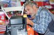 mechanic male in automobile garage processing diagnostic