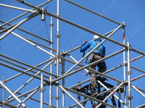 Fotografie, Obraz  Construction worker working on scaffolding