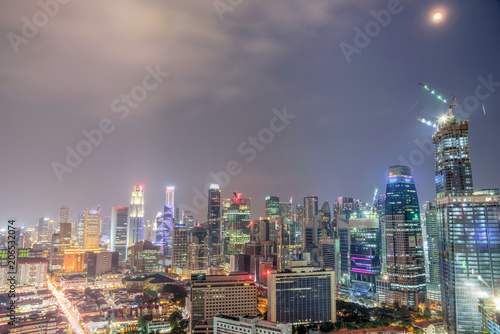 Fototapeta Aerial view of business, residential and under construction buildings skyscrapers at Singapore city center. Modern cityscape at blue hour obraz na płótnie