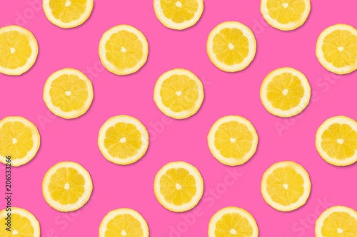 Colorful fruit pattern, Lemon slices on a pastel pink background. Top view. - 206533266