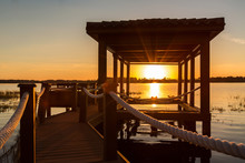 Wooden Lakeside Dock At Sunrise