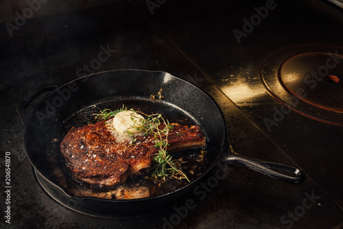 Fotografie, Obraz  Cooking steak in a cast iron pan.
