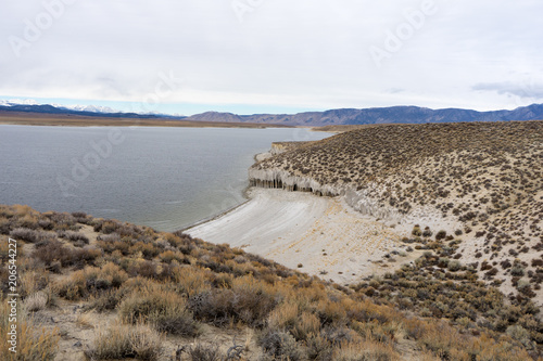 Crowley Columns as seen from above with a beautiful beach on the Crowley Lake sh Wallpaper Mural