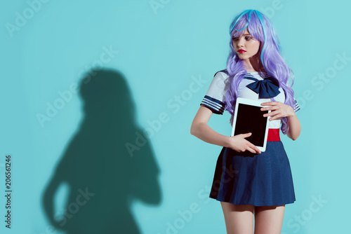 stylish girl in bright wig holding digital tablet with blank screen and looking Wallpaper Mural