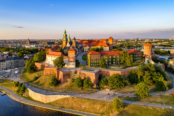 FototapetaPoland. Krakow skyline with Wawel Hill, Cathedral, Royal Wawel Castle, defensive walls,Vistula riverbank, park, promenade, walking people. Old city in the background