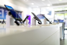 Close Up Of Cell Phones Or Mobile Phones On Display In A Modern, Clean And Contemporary Shop Or Mall