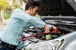 Driver's auto repair can start with server and batter on road.