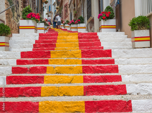 long staircase painted with the colors of the Spanish flag in a characteristic neighborhood of Calpe, Costa blanca Spain