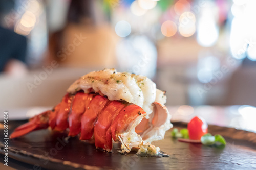 Fotografia Grilled Lobster and vegetables on plate.