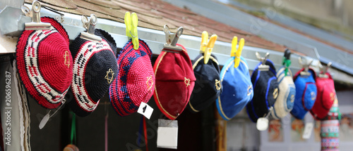 Fototapeta colored hats typical of Jews called kippahs obraz