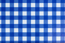 A Dark Blue Gingham Fabric Bac...